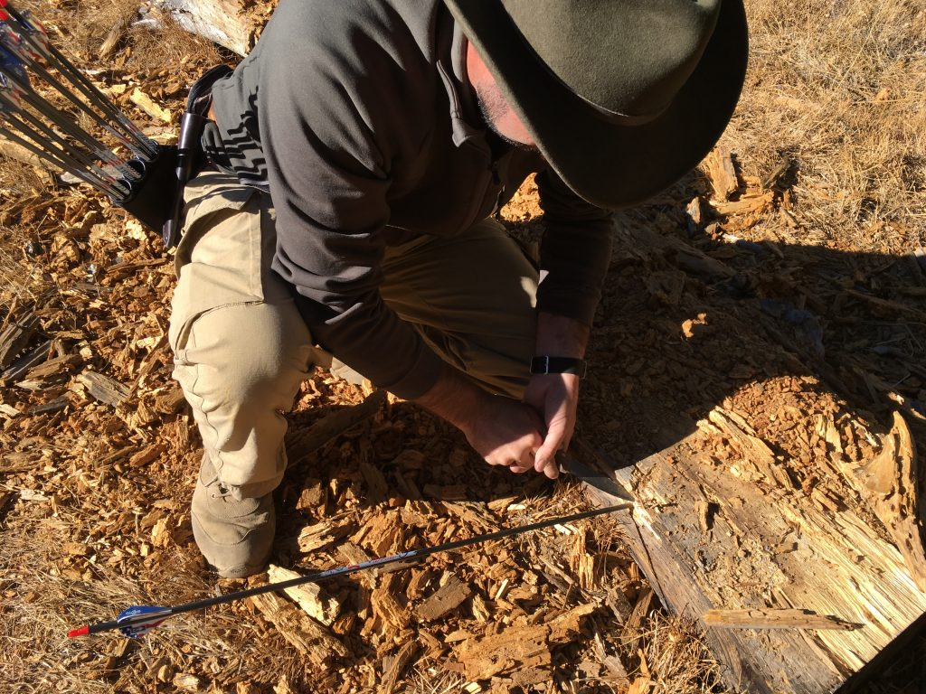 digging out arrows while tuning broadheads to field points with a condor bushlore